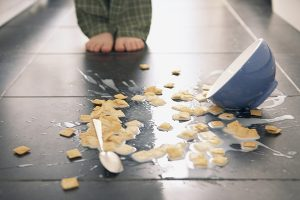 Cereal spilled onto floor --- Image by © Pauline St. Denis/Corbis